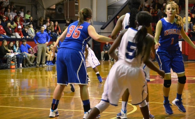Ingomar's Hannah Russell #35 and Sydney Roberts #1 defend against J.F. Kennedy on Thursday night as Coach Trent Adair looks on. Photo by Dennis Clayton.