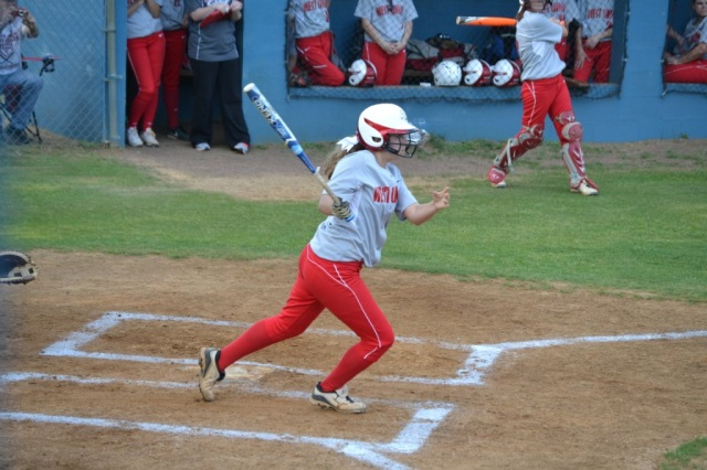 Brittany Taylor triples for West Union in the second inning, driving in two runs. Photo by Dennis Clayton.
