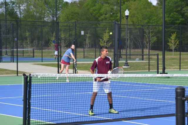 Darby Mills and Roberto Valadez were winners in mixed doubles for New Albany. Photo by Dennis Clayton.