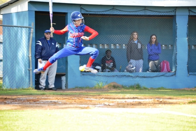 Gara Beth Self tries to leap over the inside pitch by Blue Mountain during Tuesday's win. Photo by Dennis Clayton.