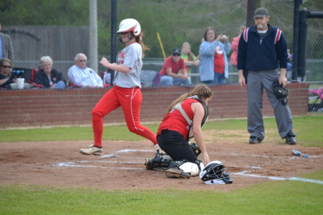 Bailey Bogue scores the game's first run as Lauren Coggin reaches for the throw. Photo by Dennis Clayton.