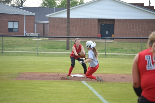 Jesslyn Brewer slides into second as Ashton Hogue tried to apply the tag. Photo by Dennis Clayton