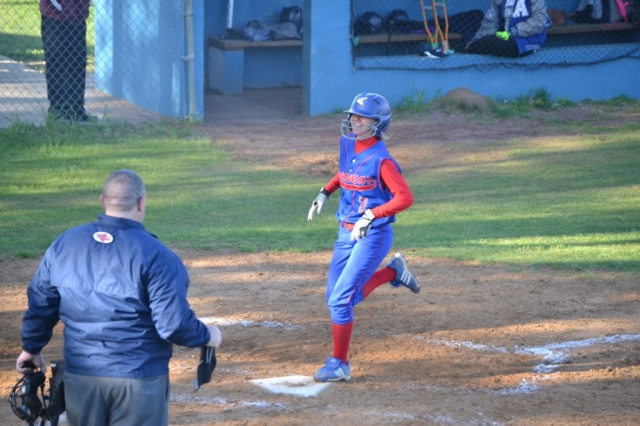 Lindsay Hall crosses the plate after her inside-the-park home run against Ashland on Tuesday. Photo by Dennis Clayton.