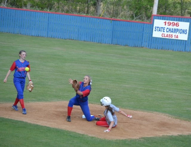 Lauren Koon takes the throw at second as Ashley Hatton slides into the base. Also pictured is Gara Beth Self. Photo by Dennis Clayton.