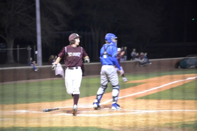 Sam McMillin scores the tying run for New Albany in the game against Senatobia. Photo by Dennis Clayton.