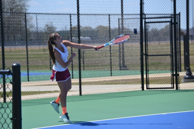 Hannah Anderson serves for New Albany. Anderson will compete for the girls doubles state championship again with new partner Quinshay Perkins. Anderson and Olivia Dunnam were the champs in 2013. Photo by Dennis Clayton.
