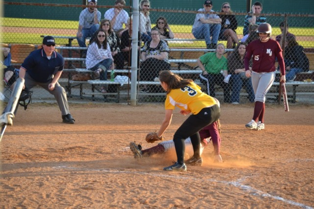 Katlyn Cavender is safe as she slides under the tag at the plate. Photo by Dennis Clayton.