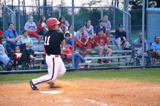 Chase Bogue drives in the final two runs for West Union with his single in the fifth inning. Photo by Dennis Clayton.