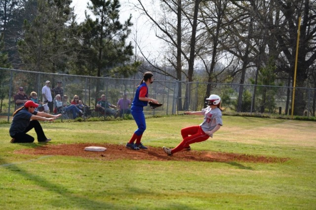 Coach Lisa Bogue of West Union holds Bailey Bogue at third while Lauren Thompson of Ingomar waits for the throw. Photo by Dennis Clayton.
