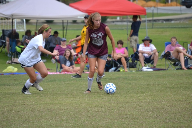 Caroline Mueller of New Albany dribbles past Kenley Stephens of Amory during their early match on Saturday morning at the Saltillo 7v7 tournament. Photo by Dennis Clayton.