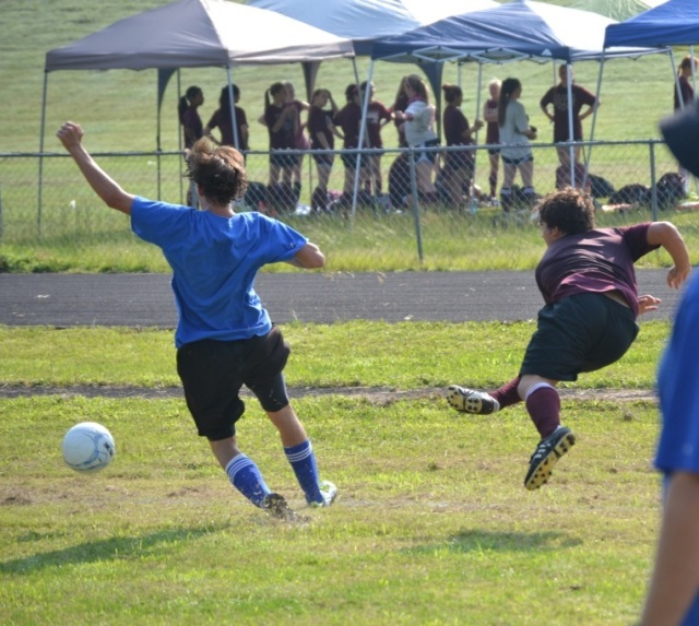 Joseph Rainey of New Albany passes the ball inside the box during Monday's 7v7 match against Saltillo. Photo by Dennis Clayton.