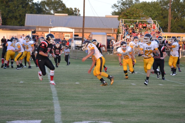 Cage West follows Chase Hall's block to break a long run in the first half for East Union. Photo by Dennis Clayton.