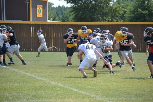 East Union has been working hard in preparation for Thursday's game with Houlka. Here the first team offense goes through a running play in Friday's practice. Photo by Dennis Clayton.