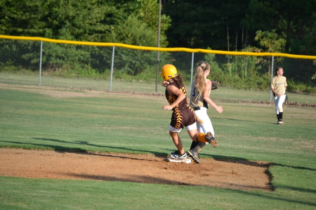 Jaley White rounds second and heads for third during Monday's game at home. Photo by Dennis Clayton.