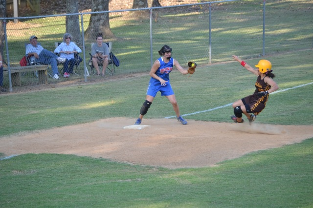 Tianna Castillo slides into third during the fifth inning as Lauren Thompson attempts to apply the tag. Photo by Dennis Clayton.