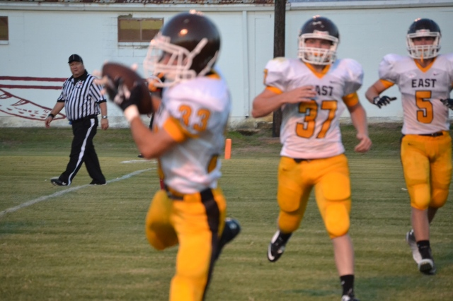 Zane Wilkinson hauls in a touchdown pass from Lane Plunk in the second quarter. Photo by Dennis Clayton.