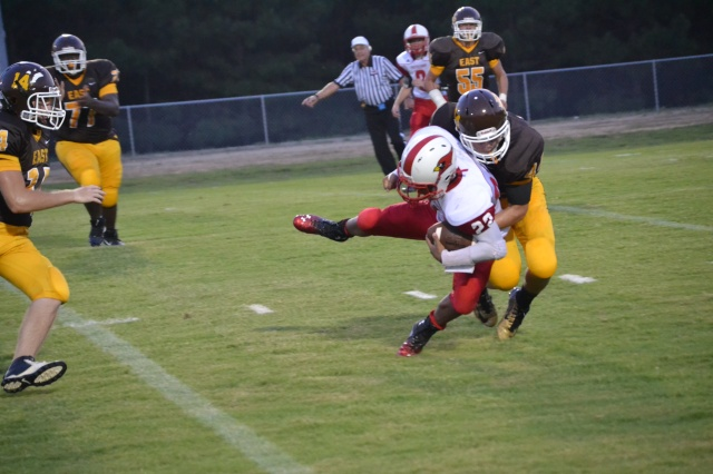 Josh Whitenton makes the tackle for loss in the Potts Camp backfield on Friday. Photo by Dennis Clayton.