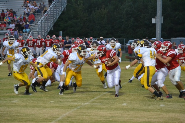 Bailey Spruill #71 and Josh Whitenton #44 move in for the tackle on the Strayhorn runner. Steven Call #82 and Austin Colburn #50 also help in stopping the play. Photo by Dennis Clayton.
