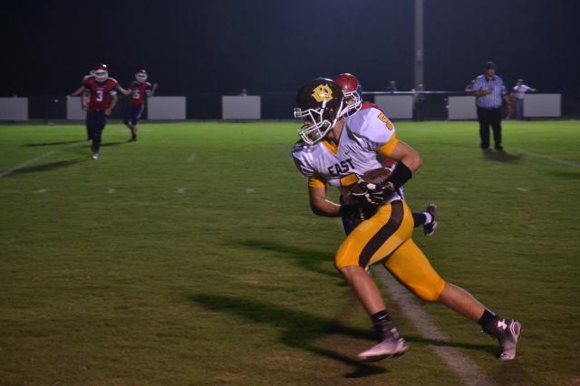 John Isaac Roberts hauls in the Zane Wilkinson pass for a 13 yard touchdown. Photo by Dennis Clayton.