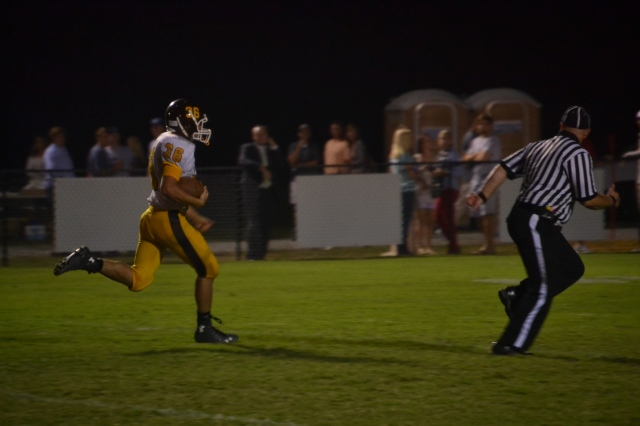 Craig Hutchens breaks loose for a 56 yard touchdown in the third quarter. Photo by Dennis Clayton.