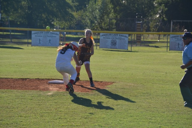 Kallie Roberts tries to turn the double play as she pivots and fires the throw to first. Photo by Dennis Clayton.