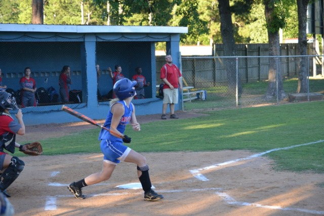 Maggie Smithey drives her double into deep left field in the fifth inning. Photo by Dennis Clayton.