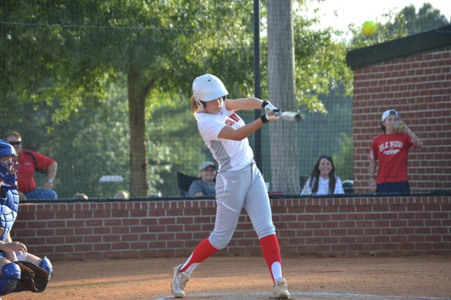 Jesslyn Brewer drives a pitch to right in the first inning on Tuesday. Photo by Dennis Clayton.