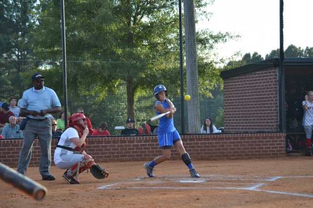 Carson Grisham delivers a two RBI single for Ingomar in the second inning. Grisham was also the winning pitcher for the Lady Falcons. Photo by Dennis Clayton.