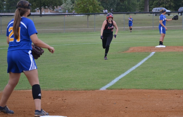 Kellan Tanner heads for third with her stand-up triple in the first inning. Photo by Dennis Clayton.