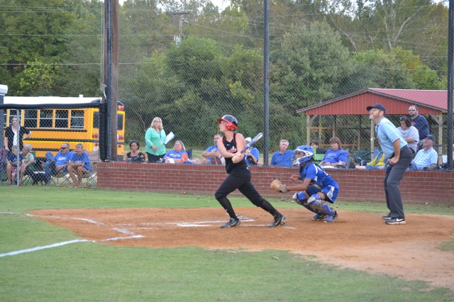 Heather Smith watches her solo home run clear the fence in the fifth inning on Thursday. Photo by Dennis Clayton.