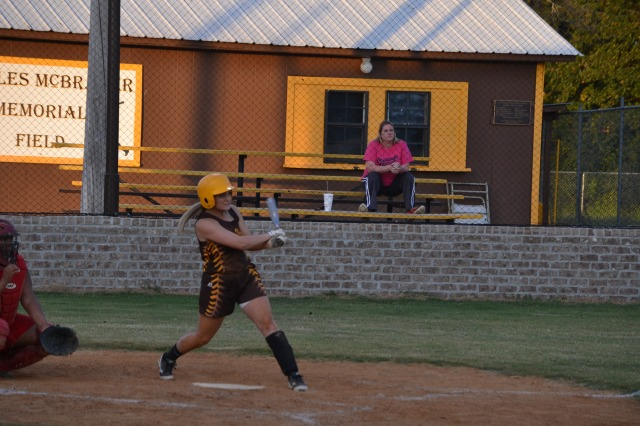 Rebecca Sheffield doubles against Strayhorn and drives in two runs. Photo by Dennis Clayton.