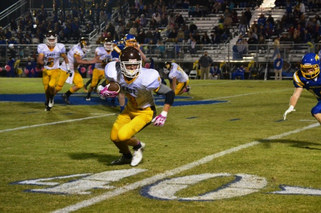 Thomas Moore heads to the sideline after making the catch on Zane Wilkinson's pass. Photo by Dennis Clayton.