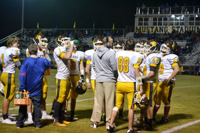 Coach Scott Duley huddles with the Urchin defense during a timeout at Mantachie. Photo by Dennis Clayton.