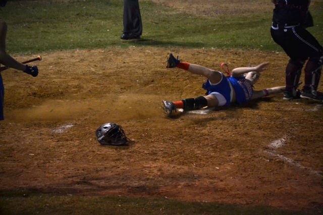 Gara Beth Self slides home with Ingomar's first run in game two against Smithville. Self doubled and scored on Maggie Smithey's double. Photo by Dennis Clayton.