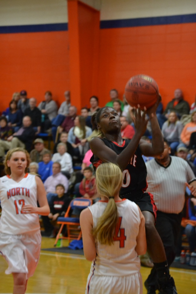 Ivory Montgomery drives in for two against North Pontotoc. Photo by Dennis Clayton.