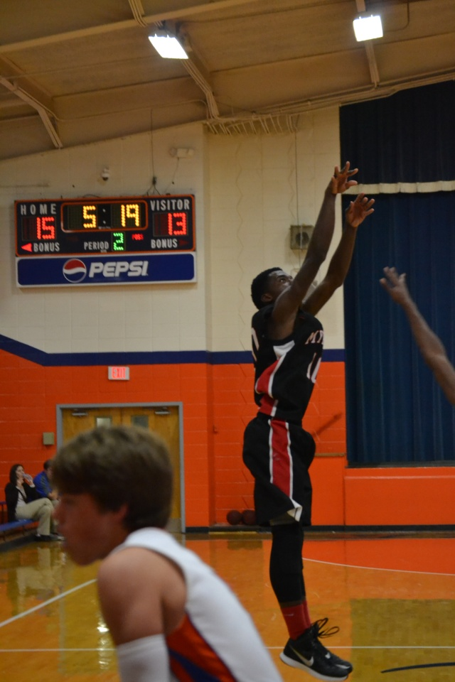 Dee Johnson drains a 3-pointer for Myrtle in the first half at North Pontotoc. Photo by Dennis Clayton.