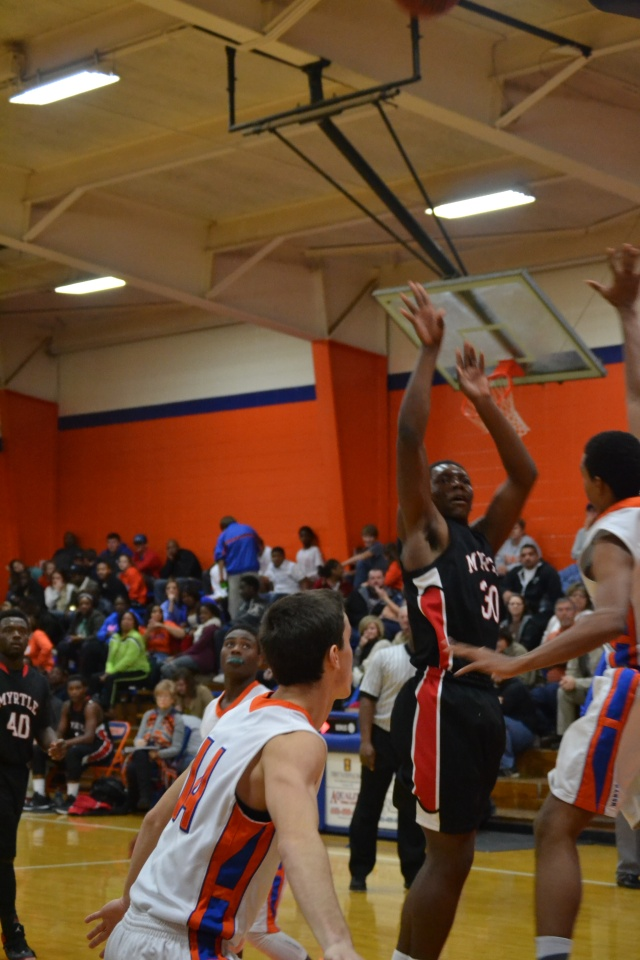 Abiram Frazier hits the short jumper for the Hawks. Photo by Dennis Clayton.