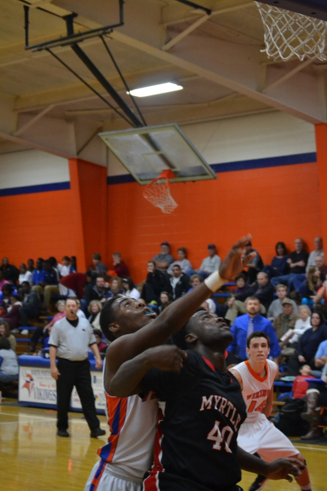 Anthony Lipsey blocks out for the rebound against North Pontotoc. Photo by Dennis Clayton.