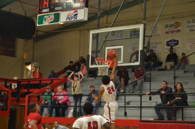 Jonathan Scales goes in for the dunk on the Myrtle fast break. Photo by Dennis Clayton.