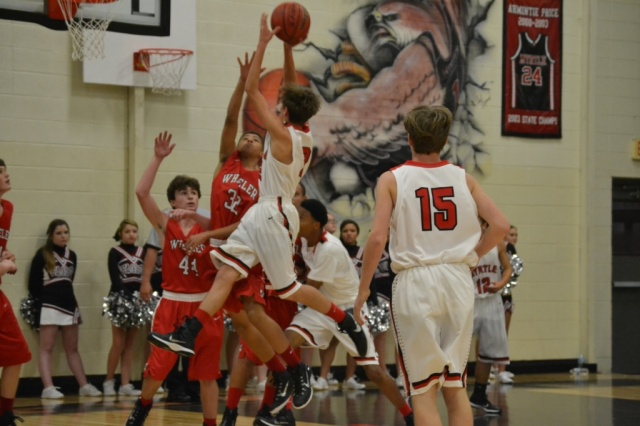 Josh Goolsby connects on this running jumper in the lane on Tuesday. Photo by Dennis Clayton.