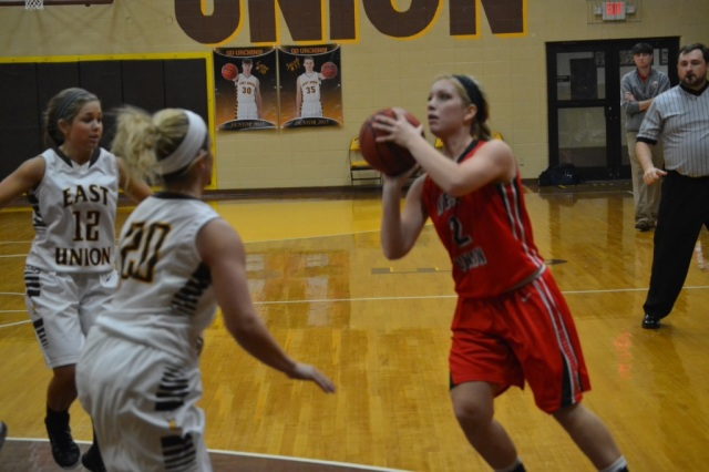 Gracen Conlee shoots the jumper for the Lady Eagles as Rebecca Sheffield defends for East Union. Photo by Dennis Clayton.