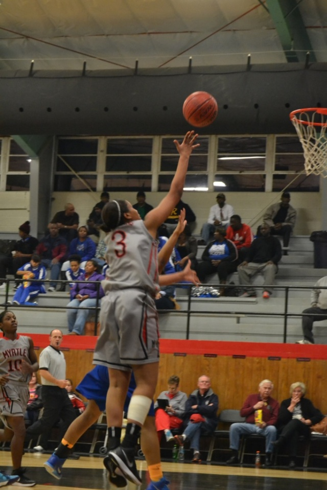 Jessica Floyd hits the shot from the lane against Ashland in the first half. Photo by Dennis Clayton.