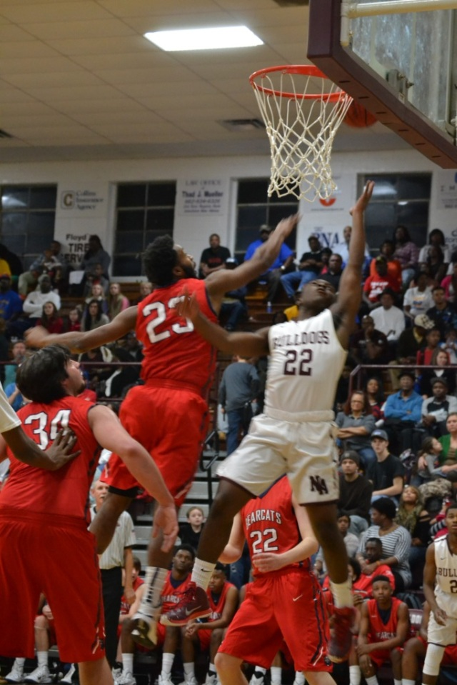 Jarel Lipsey of New Albany drives in and scores on the layup during Saturday's Hotbed Classic. Photo by Dennis Clayton.