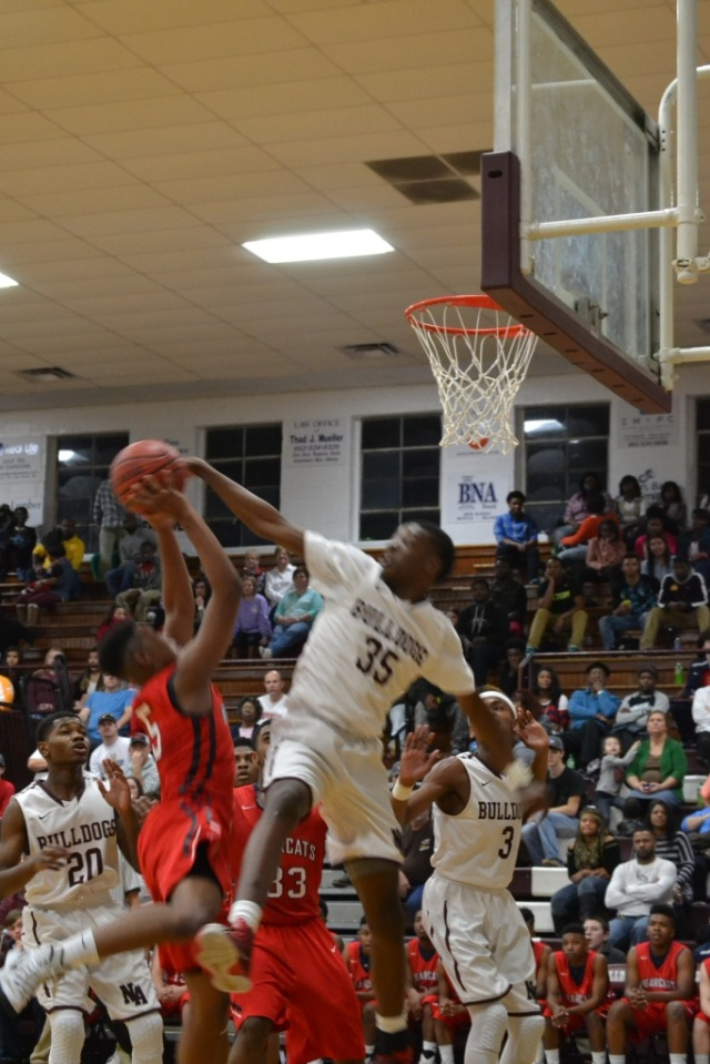 Miles Washington blocks the Baldwyn shot in the second half of the Hotbed Classic. Photo by Dennis Clayton.