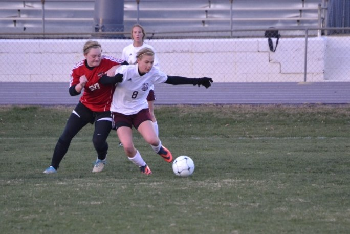 Meghan Van battles for control of the ball in the midfield during the Corinth match earlier this month. File photo.