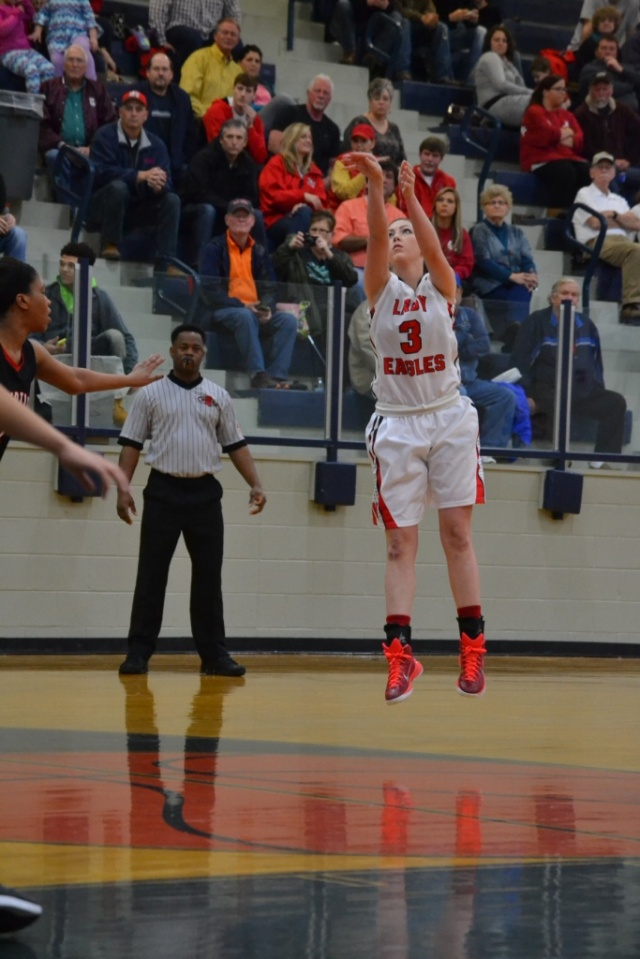 Marley Long shoots the short jumper for the Lady Eagles. Photo by Dennis Clayton.