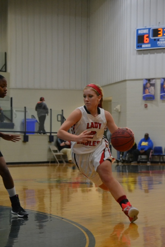 Gracen Conlee drives to the basket during the first half. Photo by Dennis Clayton.