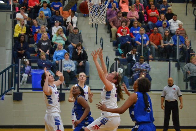 Lauren Thompson, Lindsay Hall and Mallory Russell wait for the rebound for the Lady Falcons. Photo by Dennis Clayton.