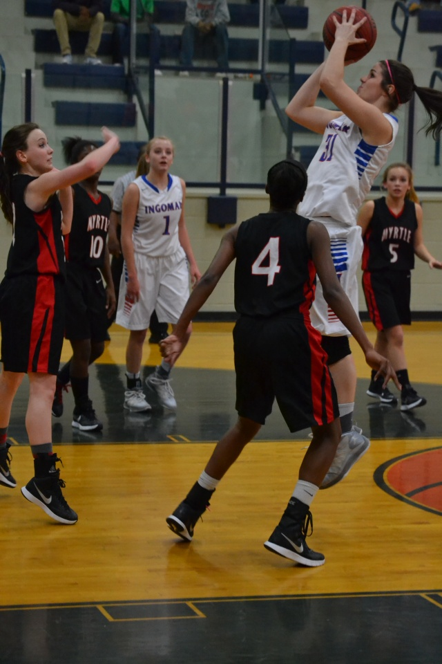 Lauren Thompson scores in the lane for the Lady Falcons. Photo by Dennis Clayton.