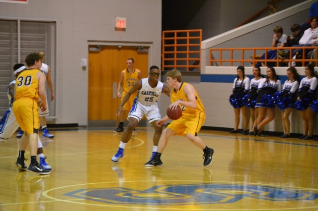Ty McDonald dribbles in against the Saltillo defensive pressure. Photo by Dennis Clayton.